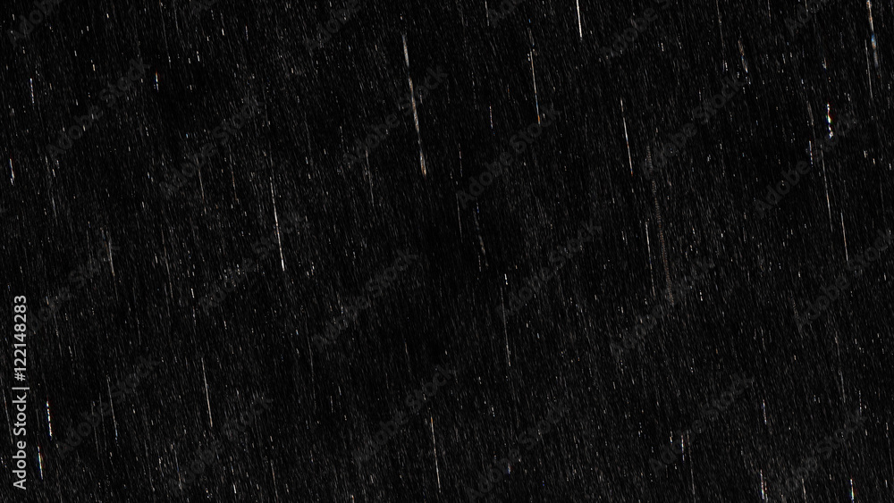 Fototapeta Falling raindrops footage animation in slow motion on black background, black and white luminance matte, rain animation with start and end, perfect for film, digital composition, projection mapping