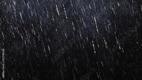Fotografia Falling raindrops footage animation in slow motion on dark black background with