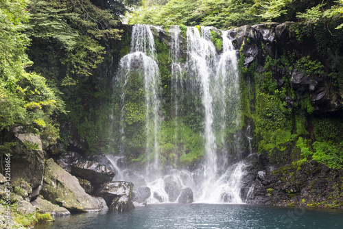 Wall Murals Ostrich Waterfall and blue lake in the Jeju island in South Korea