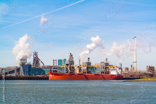 Valokuva  Steel industry plant and North Sea Canal in seaport IJmuiden near Amsterdam in N
