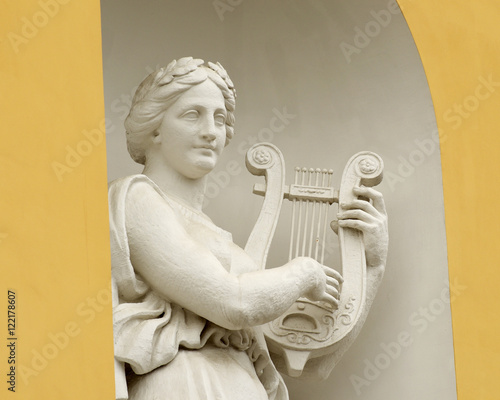 Sculpture of woman with lyre. Wallpaper Mural