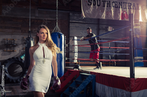 Fényképezés Knock out woman in short cocktail wedding dress walks out of the boxing ring