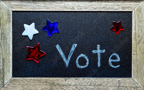 Valokuva  Vote written on chalkboard, surrounded by red, white and blue stars
