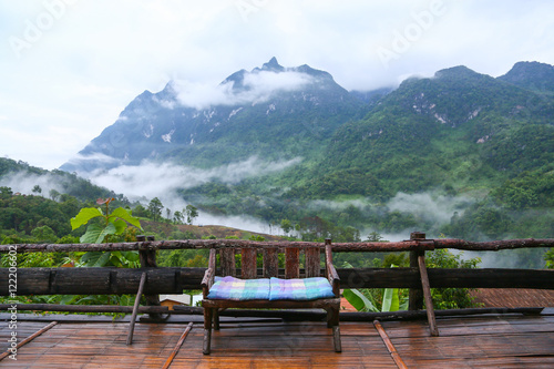 Spoed Foto op Canvas Blauwe hemel Mountain in nature and forest, Feeling good in relax day or holiday in the mountain,Forested mountain slope in low lying cloud with the evergreen conifers shrouded in mist in a scenic landscape view.