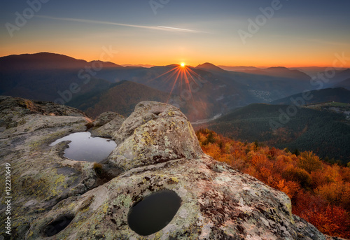 Poster Cappuccino Autumn mountain / Amazing view with first rays at Belintash rock formation, Bulgaria