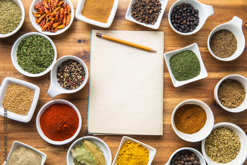 Fototapety, obrazy: Various spices and blank notebook.