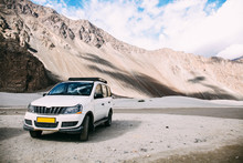 White Car Parked In Highland Mountain Scene In Leh, India