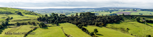 Fototapeta View of farm land and River Dove in Crowdecote
