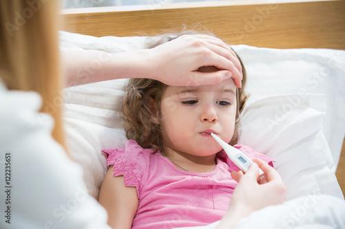 Stampa su Tela Mother measuring temperature of her ill kid