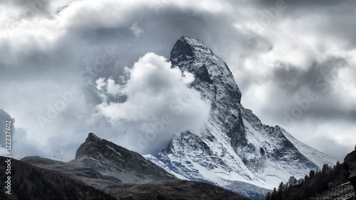 Photo  Majestic Matterhorn Mountain in Clouds, the symbol of the Swiss Alps