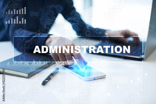 Stampa su Tela Businessman is working in office, pressing button on virtual screen and selecting Administration