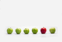 Row Of Fresh Green Apples With A Single Red One