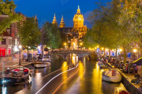 Photo  Night red-light district De Wallen, canal, Basilica of Saint Nicholas and bridge, Amsterdam, Holland, Netherlands