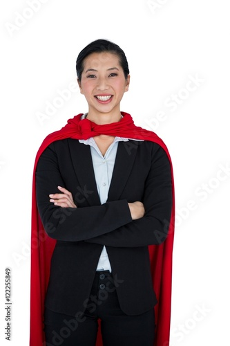 Fotografie, Obraz  Woman pretending to be a super hero on white background