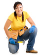 Woman working with hammer and toolbelt on white