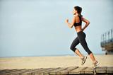 Woman running on Santa Monica Beach Boardwalk