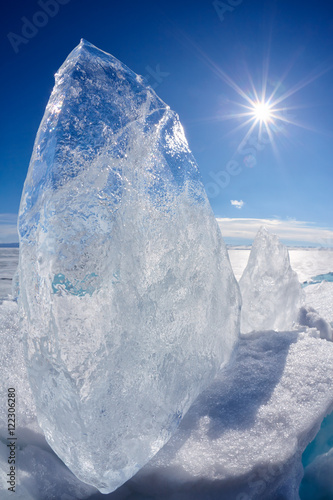 Wall Murals Arctic Ice floe and sun on winter Baikal lake