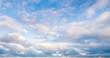 Leinwandbild Motiv Clouds over blue sky in summer day, background