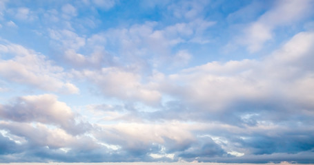 Clouds over blue sky in summer day, background