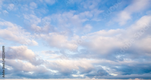 Foto op Canvas Hemel Clouds over blue sky in summer day, background