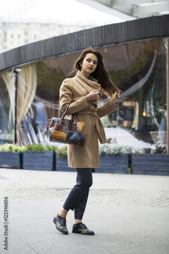 Fototapety, obrazy: Portrait of a young beautiful woman in beige coat