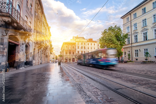 Photo  Blue tram rides on the morning  old european city.vintage picture