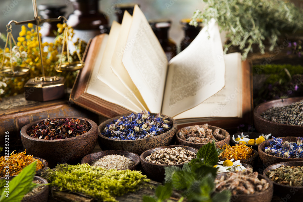 Fototapety, obrazy: Book and Herbal medicine on wooden table background