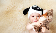 One Year Old Baby Lying In Sheep Hat On Lamb Wool