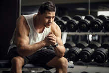Thoughtful Serious Sportsman Sitting In A Gym