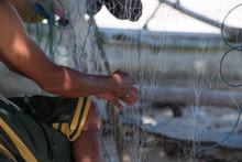 Fisherman Hand Repairing Fishing Net Detail