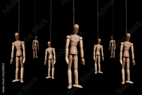 Fotografie, Obraz  Low key, wooden figures hangman by rope, on black background