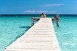 XXX - Wooden Jetty at the Mediterranean Sea with young people in the sun - 4113