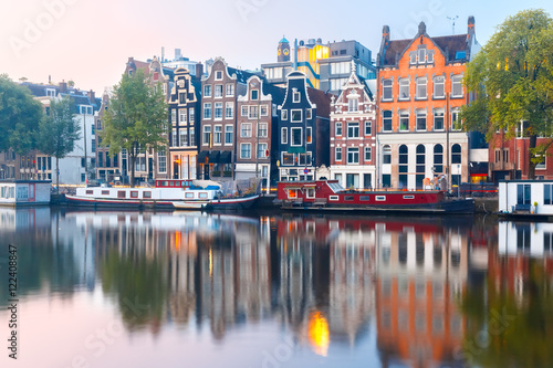 Photo  Amsterdam canal Amstel with typical dutch houses and boats during sunrise, Holland, Netherlands