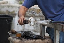 Glassblower Working On A Piece