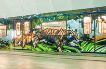 """New Painted Personalized Train """"Striped Express"""" Dedicated To The Amur Tigers With The Doors Closed At The Metro Station Timiryazevskaya In Moscow"""