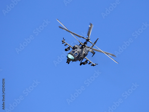 Tuinposter Helicopter Combat helicopter in flight