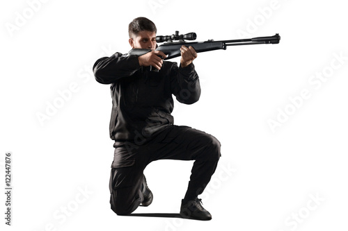 Fotografía  Soldier with sniper rifle aiming isolated on white
