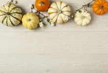 Miniature Pumpkins On Rustic Wood Background. Simple, Natural Country Style Fall Autumn Decorations.