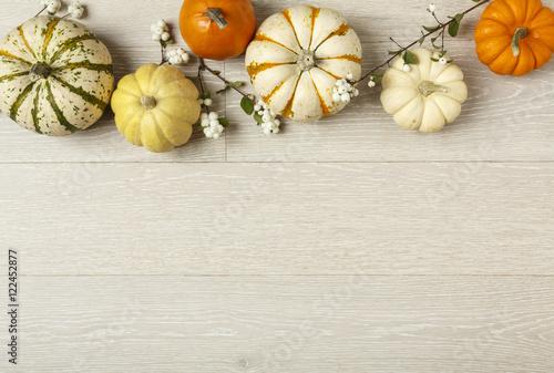 Fotografie, Obraz  Miniature pumpkins on rustic wood background