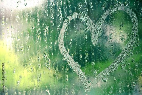 Naklejka na szybę Heart shape on glass from finger