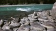 cairn, Stones on the shore of the turquoise mountain river