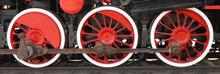 Three Wheels Of Steam Locomotive On Rails Closeup