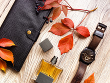 Closeup Of Men's Accessories And Essential Items On Wooden Background. Flat Lay, Top View, View From Above