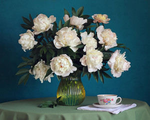 Obraz Still-life with a bouquet of peonies and cup.