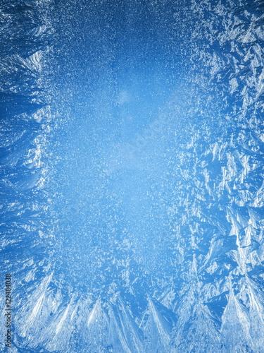 Fotografie, Obraz  Frosty patterns on the edge of a frozen window.