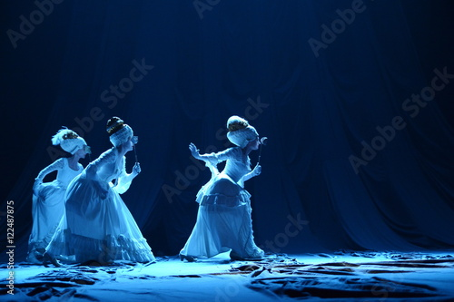 Photo  Three girls in vintage dresses actress on stage