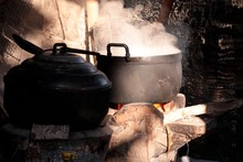 Old Pot Of Food Cooking On Burning Wood Fire Stove
