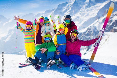 Fotobehang Wintersporten Family with kids in the mountains