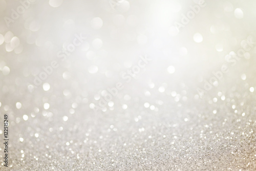 fototapeta na ścianę Silver glittering christmas lights. Blurred abstract holiday background