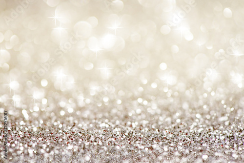 Obraz Silver white glittering Christmas lights. Festive abstract glitter bokeh background - fototapety do salonu